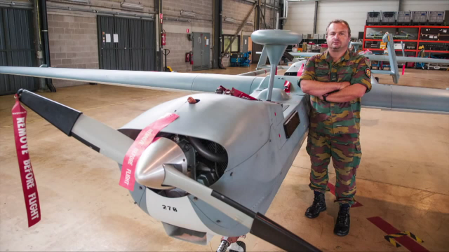 Major Ruaux, commander of a Belgian UAV Squadron, next to the B-Hunter which Belgium currently operates.